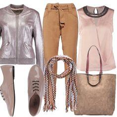 Look raffinato per la donna in carriera, adatto infatti all'ufficio e al tempo libero. Comodo grazie alla scarpa vernice a tacco basso e maxi borsa per documenti e pc. Bellissimo il giubbotto color ombretto rosa perlato e la sciarpa che racchiude tutti i colori dell'outfit.
