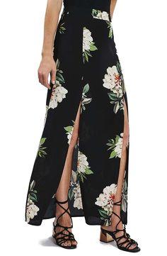 Soft voluminous blossoms offset the sharp thigh-high splits of a dramatic maxi skirt made of fine fabric.