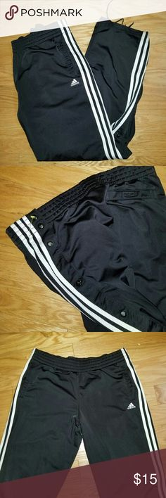 ADIDAS BLACK WHITE-STRIPED SWEATPANTS PANTS | ADIDAS BLACK WHITE-STRIPED SWEATPANTS PANTS | Size Unknown | Measurements done laying Flat; therefore, it's an approximation. |  Inseam: Waist: | Has buttons on the sides of both, left and right, pants. You can leave them unbottom of buttoned to show off some leg, or not | There is one flaw to the pants. The bottom's ends are torn up and distressed. Other than that, all pockets are fully functional. All the buttons are functional Pants Sweatpants…