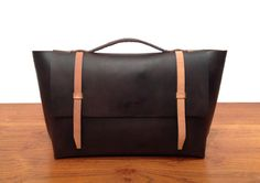 Leather laptop shoulder bag by SoftGeometryCo on Etsy, $500.00 -- sort of like this. with the smooth lines and simple details