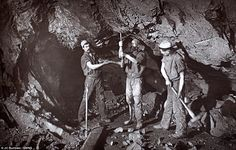 Digging for victory: Here workers in East Pool Mine start work on a bore hole headed towards the surface