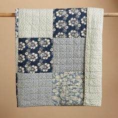 """Blue floral prints reveal their faded glory in our season-spanning quilt. It's made the traditional way—handquilted and pieced by hand—and it makes an artful addition to any bedroom. Cotton. Machine wash. Imported. Queen, 92""""W x 96""""L"""