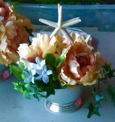https://www.facebook.com/beadedfrogdesigns custom wedding arrangements