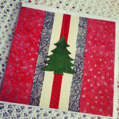Handmade Christmas card with wooden tree shape.