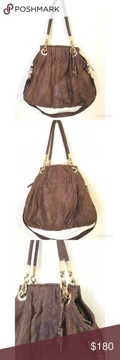 "Jenrigo Genuine Leather  Shoulder Bag ✨ •Gorgeous Genuine Leather Jenrigo Italian brown snakeskin embossed XL hobo style convertible shoulder bag 💖 Good Condition  •Detachable 1 inch wide, 14 inch drop, flat snakeskin embossed shoulder strap. •Double 10.5 inch drop snakeskin embossed rolled leather top handles. •Polished gold tone hardware accents and Jenrigo medallion.  •Full zip top closure.  •Super spacious. • A Beautiful rich red color interior • Size 19.5""L x 17.5""H x 6""W Jenrigo Bags…"