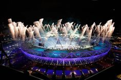 Fireworks ignite over the Olympic Stadium during the Opening Ceremony for the 2012 Olympic Games on July 27, 2012 at Olympic Park in London, England.  (Jamie Squire/Getty Images)  PHOTO LINK