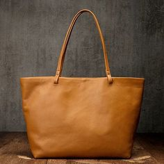 "Material: Cowhide Color: Tan Dimensions:Inches: Height 11"" x Width 12.6""-17.7"" x Depth 5.1"" Inches Backpack Bags, Tote Bags, Shopper Tote, Vintage Bags, Purses And Bags, Backpacks, Leather Totes, Handmade Leather, Stuff To Buy"