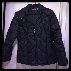 Puffy Black Jacket Black puffy jacket with faux fur around removable hood. Like new! Jackets & Coats