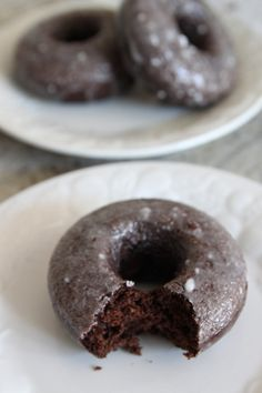 Whole Wheat Chocolate Cake Donuts with Vanilla Glaze from Bran Appetit #baking #recipe (the whole wheat makes it healthy right??)