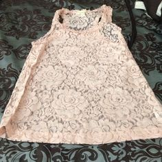 Light pink lace tank Light pink lace flowered tank top. Never been worn. Forever 21 Tops Tank Tops