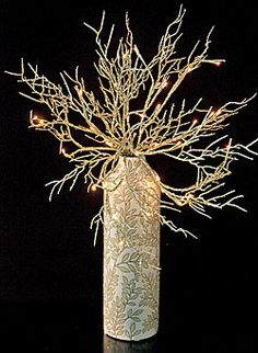20'' Lighted Gold Coral Willow Branch 40 Bulb Electric - Add glitz to your holiday décor with the addition of these stunning branches. Each intricate branch is adorned with the colors of the season. From classic champagne gold, and eye-catching copper to frosty white, no design is complete without the addition of these remarkable lighting elements!