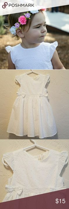 🎉HP🎉 White Eyelet Flower Girl Dress 12-18M This lovely dress is in excellent used condition. It was worn once for my brother's wedding. The cap sleeves are adorable. It's 100% cotton and is lined with a layer of tulle along the bottom. The fit is slightly larger than expected (my average height girl wore it around age 2.)    *Generously selected as a Host Pick for the 4/12 Everything Kids party-yay🎉!!!  Bundle and save. No trades please. H&M Dresses Formal