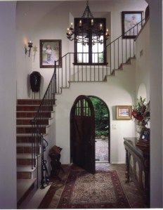 Spanish revival entry. Love the staircase over the door.