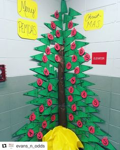 How cute is this Christmas tree Ms. Evans made with math pennants? There are more holiday math classroom decor ideas on my blog scaffoldedmath.com How To Make Christmas Tree, Christmas Math, Christmas Activities, Math Activities, Math Games, Christmas Crafts, Christmas Door, Math Classroom Decorations, Preschool Classroom