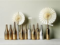 30 Minute Centerpieces - CHAMPAGNE & WINE BOTTLES make an unbelievably opulent centerpiece when massed out and sprayed entirely with gold by sheena