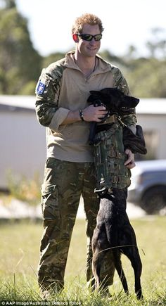 Supplied image of Captain Wales using a military working dog during a Counter Terrorism exercise with 2 Commando Regiment