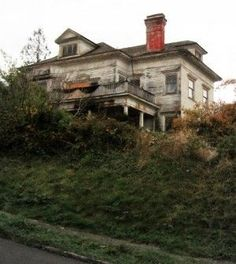 Abandoned and owners on the run, the Harry Flavel House in Astoria, Oregon, remains abandoned and neglected. by Hercio Dias