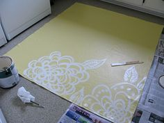 Painted floorcloth design - Yellow with white Zendoodle style designs. Nice.