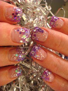 Glittery nails.  http://nailartbyamyblair.blogspot.com/2010_05_01_archive.html?m=1