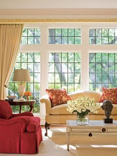 The red raspberry chair is the perfect pop of color in this room! www.ACBoardwalkRealty.com
