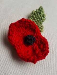 Handmade Knitted Poppy Stocking Completed Fitting in Knitting Children Craft Ideas Knitted Poppy Free Pattern, Leaf Knitting Pattern, Knitted Flower Pattern, Knitted Poppies, Baby Cardigan Knitting Pattern Free, Knitted Doll Patterns, Knitted Flowers, Knitted Dolls, Knitting Patterns Free