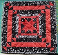 Mini quilt red black and white