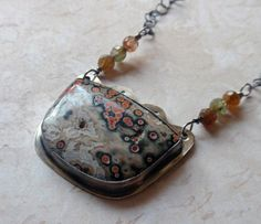 I love ocean jasper, and this cab is one of my favorites! I set it in oxidized sterling silver.