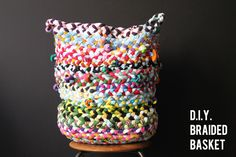DIY braided basket made from old t-shirts. This would be the perfect toy basket. // Corner Blog