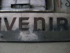 """A segment of the word """"souvenir"""" from the abandoned Oakland 16th St train station"""