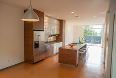Modern Kitchen with Undermount sink, Slate counters, Breakfast bar, Slate, Pendant light, One-wall, European Cabinets, Flush