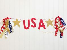 This Felt Banners will add the perfect touch to your Holiday Decorations! Would be so cute hung across a mantel or room for all your patriotic Holidays! They even look great in front of another banner! Letters are 6 inches tall and made from Stiffened Felt which is much more durable than regular felt. The phrase in this listing is for USA which includes a Star on both sides in either Gold or Silver Sequin.  The banner comes hung on 8 ft of coordinating decorative twine. Letters can easily be…