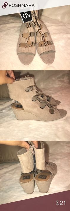 DV by Dolce Vita Gabi Gladiator Strappy Shoes NWT DV by Dolce Vita Gabi Gladiator Strappy Shoes NWT.  Has zipper on the side for easy off / on access.  Faux suede material in a tan color.  Insole is cushioned for comfort DV by Dolce Vita Shoes Sandals