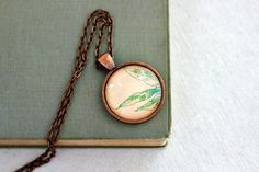 Peach and mint floral necklace bohemian jewelry from vintage sheet music abstract  illustration leaves. $28.00, via Etsy.