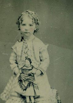 Tintype of a girl with a doll.