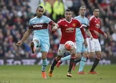 French midfielder Payet plays a nice pass under pressure from Manchester United youngster...