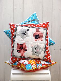 Three cute applique patterns to make fun and adorable cat cushions. The finished size of two cushions is 18, the smaller one is 16 The