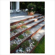 Corten steel. plantings along side steps.