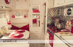 Vintage Trailer decorated in red and cream...love it!