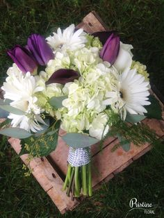 Purple Green White Bridal Bouquet designed with Hydrangea, Tulips, Roses, Calla Lilies, Gerbera Daisies, finished with Accents