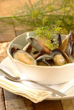 Fresh mussels steamed in white wine with a creamy garlic sauce – a delicious treat! Seafood Meals, Seafood Dishes, Seafood Recipes, Dinner Recipes, Mussel Recipes, Fish Recipes, Food Network Recipes, Cooking Recipes, Healthy Recipes