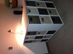 I'm toying with this idea not sure how to fit in my tiny family room/ office.  3 9 cube cubbies and a glued panel top.