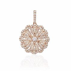 NEW: Sparkling swirls of rose gold encrusted with 210 white diamonds, surround 1 round brilliant center white diamond. 18k rose gold diamond pendant 1.70ctw measures 33mm in length and 23mm at widest point. $3,915