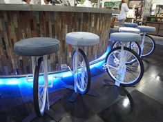 """what an amazing way to create seats for the breakfast bar or stools in the retro design led interior living space Recycle idea for Old bicycle- someone open a bar named """"The Wheel"""" :) Cafe Interior Design, Cafe Design, Recycled Furniture, Diy Furniture, Old Bicycle, Bicycle Wheel, Bicycle Bar, Bicycle Rims, Bicycle Seats"""