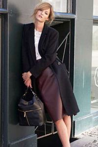 White blouse, Burgundy Faux Leather Panelled Pencil Skirt, black bag & a black coat to finish off your stylish office look.