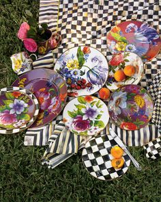 "MacKenzie-Childs ""Flower Market"" Dinnerware  As seen on FoodandWine.com ""3 Tips for Mixing Fall Florals at Home"" (October 10, 2012).    Set your table with this whimsical, handcrafted enamelware decorated with multicolor florals on black, blue, green, and white backgrounds. By MacKenzie Childs®."