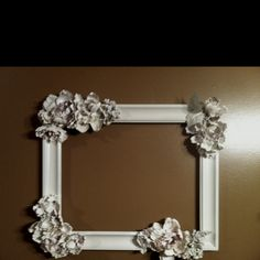 My first original pin!!! The frame I made for Harper's room. Silk flowers hot glued to a frame- spray painted white! I am going to put fabric behind it, or maybe a wooden H?