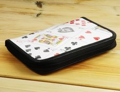 This mini ipad / tablet case is made using a collage of playing cards.  Features two inner pockets, rubber bands to hold your mini ipad or Tablet safely. Lined with a soft sponge for protection.  Polyester fabric uses for the lining. Using YKK zipper Vinyl trimming  Dimensions in inches: 8.6 long, 6.2 wide, 1.1 thick Dimensions in centimeters: 22 cm long, 16 cm wide, 3 cm thick  Weight: 4.6 ounce (130 grams)  **************************************************  More designs for ipad and T...