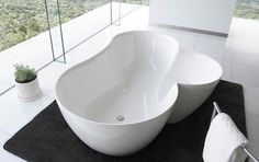 Customized bathtub with a mini extension. Small, compact yet classy. This is a great design when you need more room in the tub and not make it take so much space.