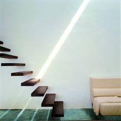 Floating stairs.  Add suspension cables or a glass balustrade wall, and we are good to go.