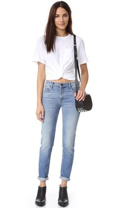 A twisted panel details the front of this crew-neck T by Alexander Wang tee. An elastic back cinches the waist. Patch breast pocket. Short sleeves.